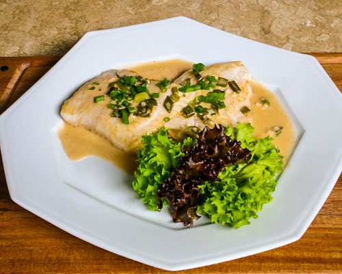 GRILLED FISH WITH COCONUT ONION SAUCE